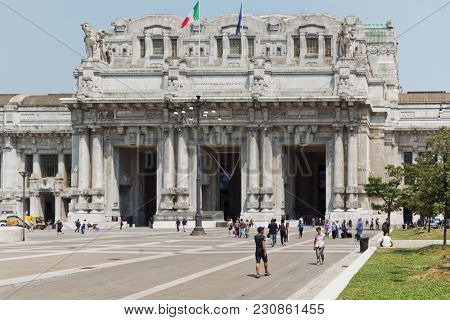 MILAN, ITALY - JUNE 12, 2017: People in front of Milano Centrale, the central train station. Designed by architect Ulisse Stacchini, the building was erected in 1912-1931