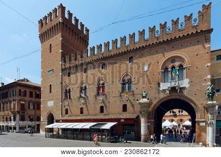 FERRARA, ITALY - JUNE 17, 2017: People walking at the Ferrara Town Hall. Begun in 1245, the City Hall was the residence of the Este family until the 16th century
