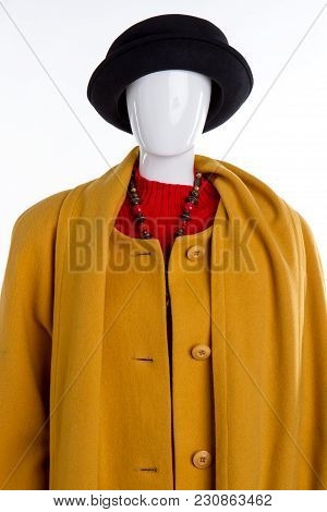 Warm Winter Clothing. Yellow Coat And Black Hat, Front View. White Isolated Background.