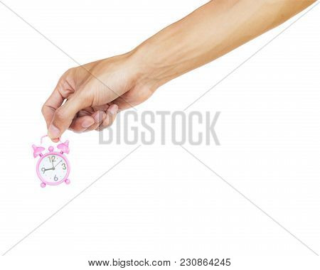 Hand Holding Pink Alarm Clock Isolated On White Background With Clipping Path. Alarm Clock Is A Cloc