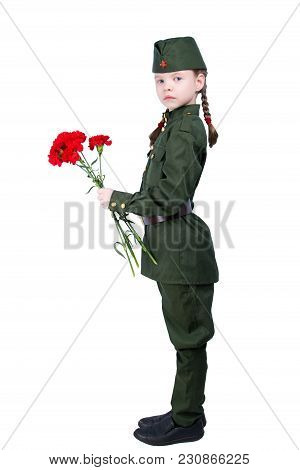 Child Girl Standing In A Uniform With Red Flowers Sideways, On A White Background, And Looking At Yo