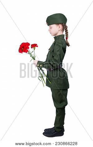 Child Girl Standing In A Uniform With Red Flowers Sideways, On A White Background