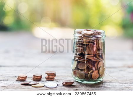 Save Money And Account Banking For Finance Business Concept, Piggy Bank With Coin Money On Wooden An