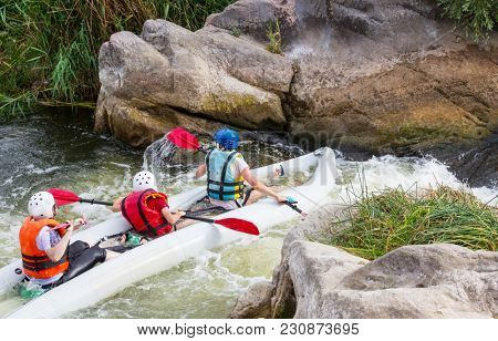 Kayaking on the mountains river in summer season