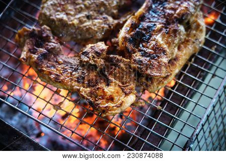 Meat On The Grill With Flame. Outdoor Bbq