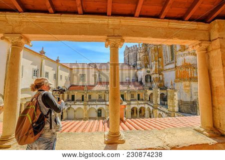 Photographer With Stabilizer And Professional Camera Takes Photos At Cloister Of Santa Barbara. The
