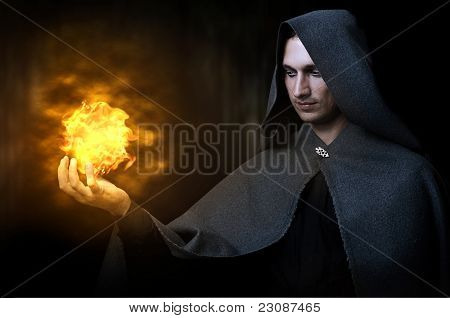 Halloween Concept. Male Wizard With Fireball
