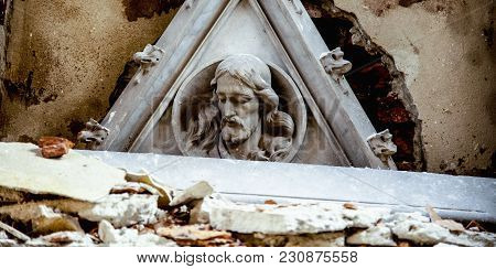 The Ruins Of The Church. Broken Fragment Of Ancient Statue Of Jesus Christ As Symbol Of Atheist Tend