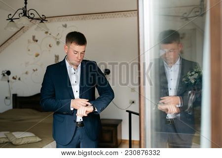 Buttoning A Jacket Hands Close Up. Stylish Man In Suit Fastens Buttons And Straightens His Jacket Pr