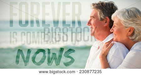 Forever is composed of nows against woman hugging her husband while standing at beach