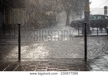 Rain In The City. Road, Pavement, Car In Rain, Close Up. Water Splashes, Spills On Roadway.