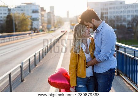 Young Couple In Love Hugging Dating And Kissing Outdoor
