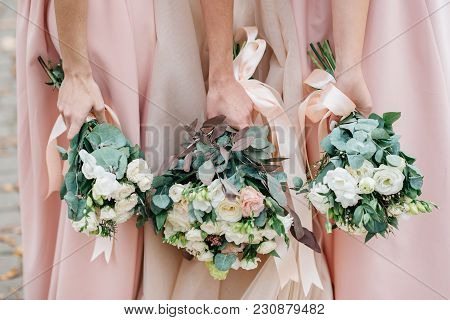 Wedding Flowers In Hand The Bride And Her Bridesmaids. A Feast For Brides