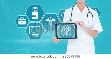 Midsection of female doctor showing digital tablet against digital background with dna helix