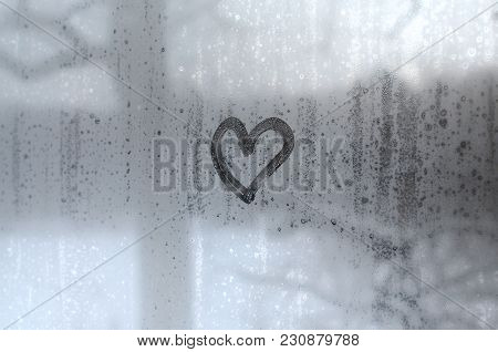 The Heart Is Painted On The Misted Glass In The Winter