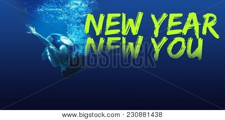 New year new you against man swimming in blue water
