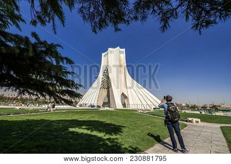 Tehran, Iran - October 15, 2016: Western Tourist In Front Of One Of The Most Famous Tehran Landmarks