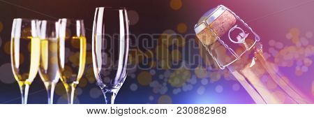 Three full glasses of champagne and one empty against zoom on top of champagne bottle