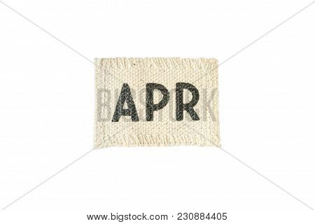 Closeup Small Picec Of Fabric Calendar In April Month Isolated On White Background