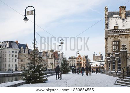 Ghent, Belgium - December 18, 2010. Tourists Walk Along Graslei In Winter Time In Central Ghent, Bel