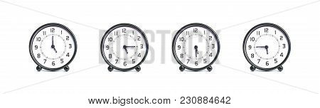 Closeup Group Of Alarm Clock For Decoration Show The Time In 5 , 5:15 , 5:30 , 5:45 P.m. Isolated On