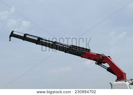 The Telescopic Arm Of A Lorry Mounted Hydraulic Crane.