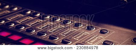 Close-up detail of sound mixer in recording studio