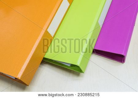 Closeup Group Of Colorful Document File On Wood Desk Background
