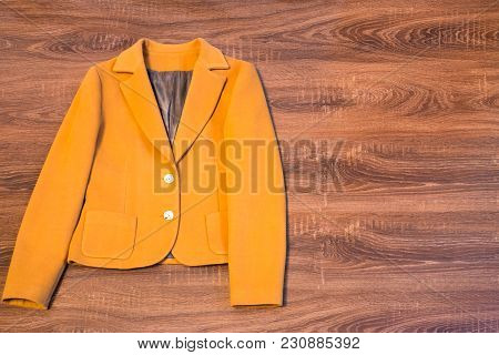 Stylish Female Blazer On Brown Wooden Background