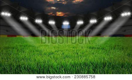 Empty Arena With Green Grass Illumination At Night