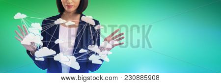 Businesswoman using invisible screen against abstract green background