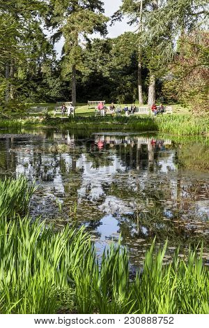 London, Uk - April 18, 2014. Visitors Enjoy The View Of The Waterlily Pond At Kew Botanic Gardens. T