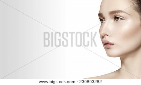 Beautiful Face Of Young Woman. Skincare, Wellness, Spa. Clean Soft Skin, Healthy Fresh Look. Natural