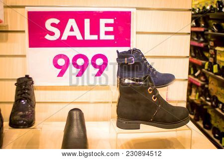 Seasonal Sale Of Winter Shoes Boot In The Store