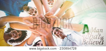 A man is what he believes against creative team putting their hands together