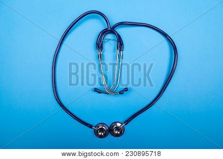 Stethoscope In Shape Of A Heart On Blue Background