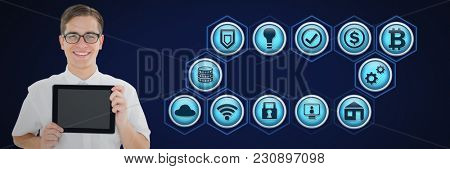 Digital composite of man holding tablet and business icons
