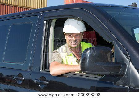 Handsome Construction Sit Man In Van With Security Helmet