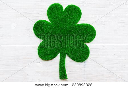 Happy St Patricks Day Message On Green Paper Clover And White Wooden Background