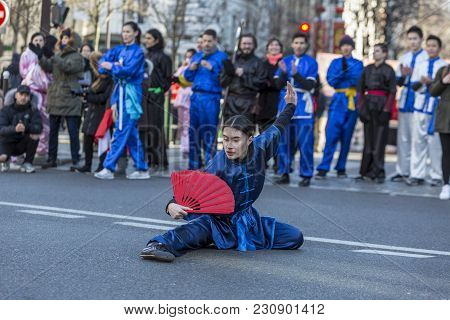 Paris, France-february 25,2018: Woan Performing Martial Arts With A Red Fan In The Street During The