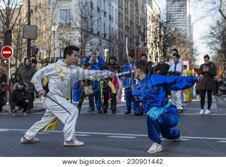Paris, France-february 25,2018: Couple Performing Swords Fighting In The Street During The 2018 Chin