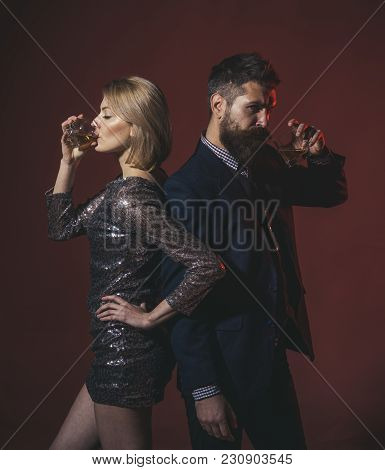 Couple In Love With Calm Face At Corporate Party. Man And Woman In Fancy Clothes Drink Wiskey On Bur