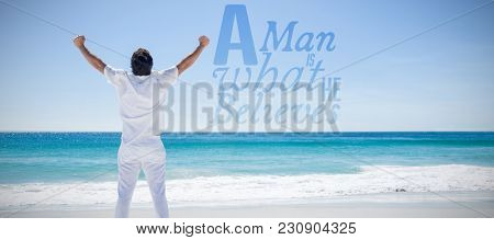 A man is what he believes against man stretching his arms in front of the sea