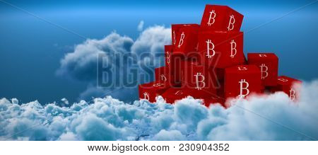 Several red square with B sign on the side against close up of clouds