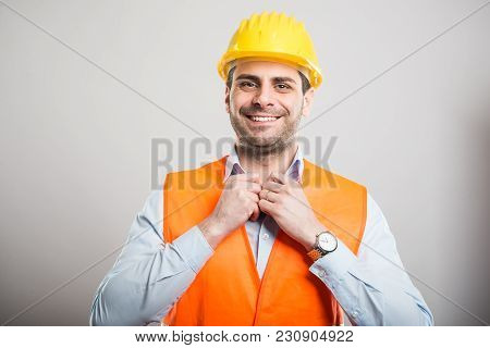 Portrait Of Young Architect Arranging His Shirt Wearing Hardhat
