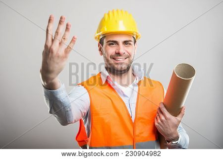 Portrait Of Young Architect Holding Blueprints Showing Number Four