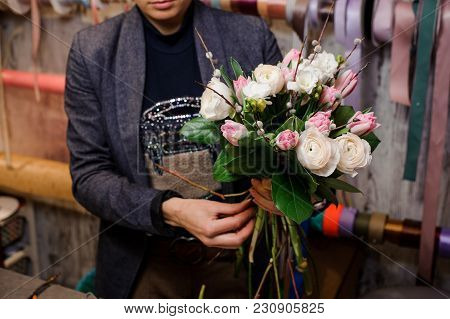 Man Holding A Tender Bouquet Of Lovely Flowers Consisting Of Pink Tulips And White Ranunculus
