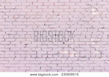 Painted Dirty Pink Brick Wall. Old Shabby Brickwork Dusty Rose Color