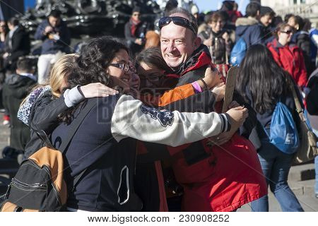 Strangers Embrace During A Free Hugs Event