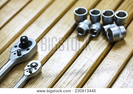 Wrenches In Mechanic Workshop. Wooden Background Theme
